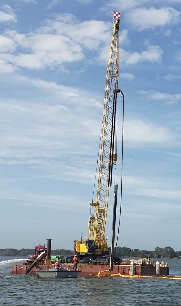 Image of Construction Crane removing old marina pilings Jan 14 2020