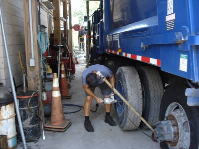Terry mounts recapped tires on solid waste truck